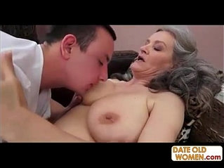 Grey hair grandmother takes it deep