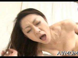 Nice-looking oriental hottie licking cock