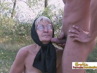Granny in black stockings fucks a stud on the field